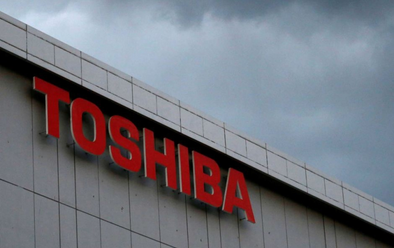 Toshiba Signs Deal to Sell Chip Unit to Bain-led Group